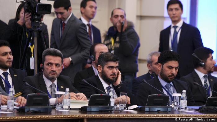 Mohammad Alloush (C), the head of the Syrian opposition delegation (Reuters/M. Kholdorbekov)