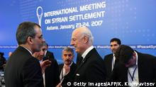 23.01.2017 **** UN envoy for Syria Staffan de Mistura (C) meets with an Iranian delegation prior to the first session of Syria peace talks at Astana's Rixos President Hotel on January 23, 2017. / AFP / Kirill KUDRYAVTSEV (Photo credit should read KIRILL KUDRYAVTSEV/AFP/Getty Images)