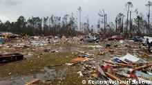 Debris covers an area of the Sunshine Acres neighborhood after a tornado struck Adel, Georgia