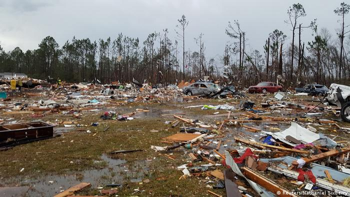 Debris covers an area of the Sunshine Acres neighborhood after a tornado struck Adel, Georgia (Reuters/Nathaniel Sixberry)