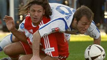 Karlsruhe's Alexander Iashvili and Munich'a Martin Demichelis challenge for the ball