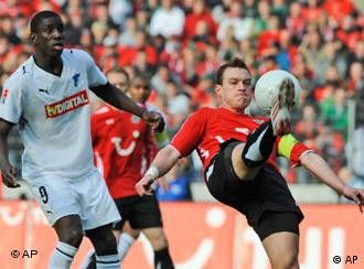 Hanover's Hanno Balitsch and Hoffenheim's Demba Ba challenge for the ball