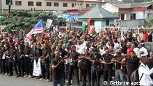 20.01.2017 *** Supporters of the Indigenous People of Biafra (IPOB) march in Port Harcourt on January 20, 2017 in support of the US president-elect. Donald Trump will be sworn in as the 45th president of the United States on January 20 -- capping his improbable journey to the White House and beginning a four-year term that promises to shake up Washington and the world. / AFP / STRINGER (Photo credit should read STRINGER/AFP/Getty Images)