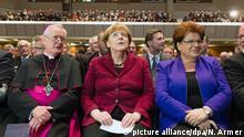 Merkel - inmitten von Katholiken
