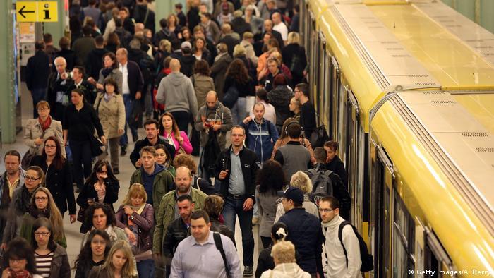 Commuters at the Alexanderplatz train station in Berlin