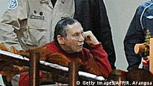 Former Panamenian dictator Manuel Noriega (red-2R) is seen after arriving at the Renacer prison, 25 km south east of Panama City, on December 11, 2011. Panamanian former dictator, Manuel Noriega,77, after more than two decades in prisons in the United States and France, returned home Sunday where he will continue to be incarcerated. AFP PHOTO/ Rodrigo ARANGUA (Photo credit should read RODRIGO ARANGUA/AFP/Getty Images)