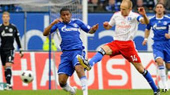 Hamburg and Schalke players battle for the ball
