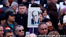 ANKARA, TURKEY - JANUARY 24: People gather to commemorate the 24th anniversary of Turkish journalist Ugur Mumcu at his assassination site near his house in Ankara, Turkey on January 24, 2017. Mumcu was assassinated with a bomb planted in his car on January 24, 1993. Mehmet Ali Ozcan / Anadolu Agency |