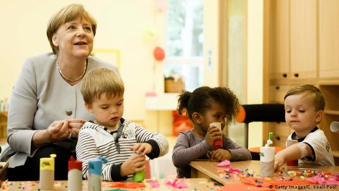 Angela Merkel with small children (Getty Images/C. Koall-Pool)