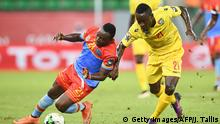Democratic Republic of the Congo's forward Firmin Ndombe Mubele (L) challenges Togo's defender Djene during the 2017 Africa Cup of Nations group C football match between Togo and DR Congo in Port-Gentil on January 24, 2017. / AFP / Justin TALLIS (Photo credit should read JUSTIN TALLIS/AFP/Getty Images)