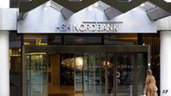 A woman walking into a HSH Nordbank office