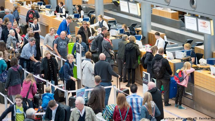 Crowds waiting to check in at Hamburg Airport in Germany
