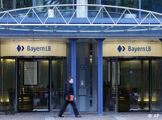 A man walks in front of a BayernLB branch in Munich