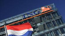 The Dutch flag flies outside ING head office in Amsterdam, Netherlands, Monday Oct. 20, 2008. Shares in ING Groep NV rebounded more than 20 percent at the start of trading Monday, after the Dutch government threw the bank and insurer a Euro10 billion (US$13.4 billion) lifeline to shore up its capital position. The move, which will temporarily make the state ING's largest shareholder, was announced late Sunday and intended to prevent the company from becoming the latest victim of the global financial crisis. ING said Sunday it would cut dividends for the rest of the year and had agreed to cancel bonuses for executives. Though the bank was not facing a run or acute solvency problems, its shares had entered an accelerating slide Friday and it said it expected to post a large loss for the third quarter. (AP Photo/Peter Dejong)