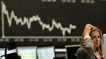 Picture of a woman in front of a falling stock index
