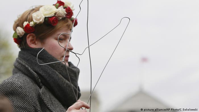 A woman protests illegal abortions in Poland