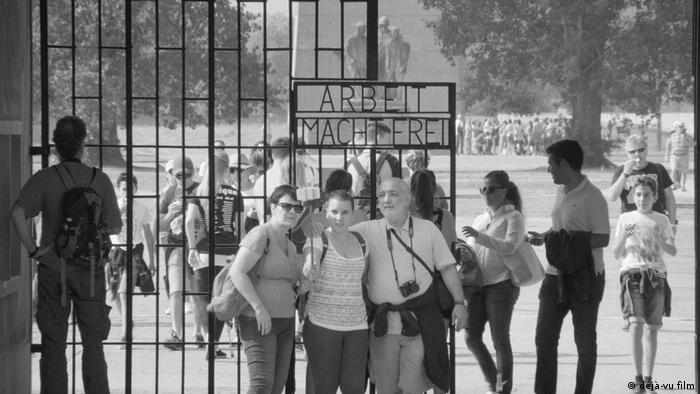 Film scene from Austerlitz with visitors of the concentration camp (déjà-vu film)