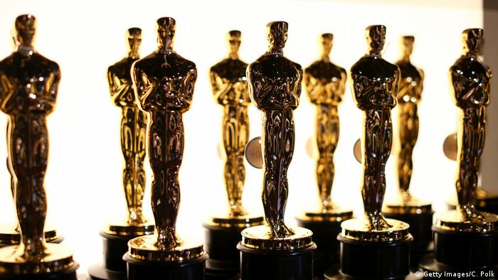 A row of oscar statuettes
