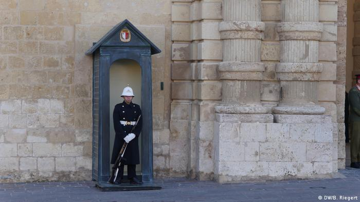 A guard stands outside the Grandmaster's Palace in Valetta