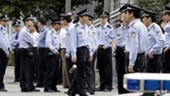Policemen stand in the grounds of the Shanghai Higher People's Court after the appeal of man convicted of killing six policemen ended Monday Oct. 20, 2008. Dozens of Chinese gathered outside the court as Yang Jia appealed his death sentence for killing six policemen in a stabbing spree in July. Yang, who drew a surprising amount of sympathy in China after being accused of the killings, will get the death penalty after losing his final appeal Monday.(AP Photo/Greg Baker)