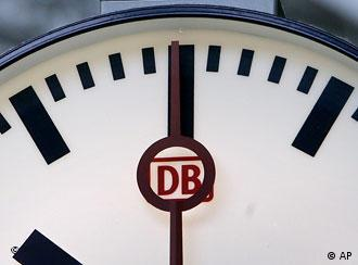 A close-up shot of a clock at a German train station.