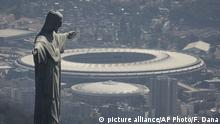 FILE - In this Aug. 1, 2016, file photo, the Christ the Redeemer statue stands above Maracana stadium in Rio de Janeiro, Brazil. Electricity has been cut at Rio de Janeiro's Maracana stadium in a battle over unpaid bills. The electric utility company says in a statement that power was cut on Thursday, Jan. 26, 2017, which was host of the 2014 World Cup final, and the opening a closing ceremonies of Rio's 2016 Olympics. (AP Photo/Felipe Dana, File) |