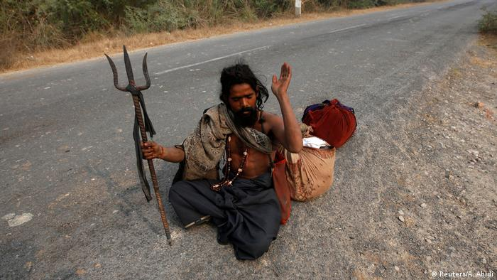A snake charmer in Baghpur, in the central state of Uttar Pradesh, (Reuters/A. Abidi)