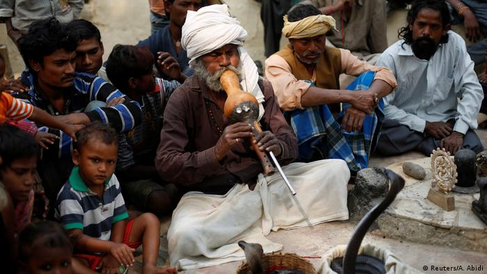 A snake charmer in India (Reuters/A. Abidi)