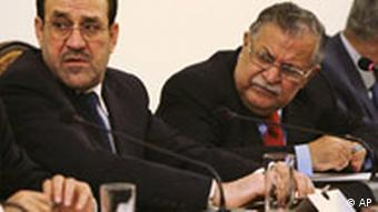 Iraqi Prime Minister Nouri al-Mailki, left, and President Jalal Talabani, right, are seen during a meeting in Baghdad, Iraq, Friday, Oct. 17, 2008. Iraq's prime minister has acknowledged weaknesses and negatives in a draft security pact with the U.S. as Shiite and Sunni clerics complain that the government hasn't informed the public about terms of the agreement. Al-Maliki has been briefing national leaders about the draft before sending it to parliament for final approval before the U.N. mandate expires at the end the year. The deal would allow U.S. troops to remain here until at least the end of 2011 and give Iraq a role in managing U.S. military operations. (AP Photo/Khalid Mohammed)