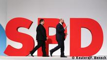 FILE PHOTO: German Economy Minister and Leader of the Social Democratic Party (SPD) Sigmar Gabriel (L) and European Parliament President Martin Schulz walk on the podium during the SPD party congress in Berlin, Germany, December 12, 2015 REUTERS/Fabrizio Bensch/File Photo