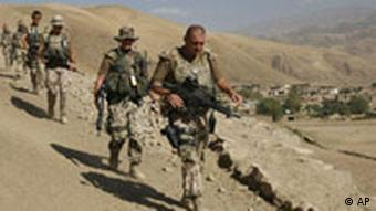 ISAF soldiers with the German Federal Armed Forces (Bundeswehr) patrolling on the outskirts of Feyzabad, northern Afghanistan.