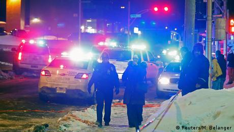 Police officers are seen near a mosque after a shooting in Quebec City, Canada (Reuters/M. Belanger)