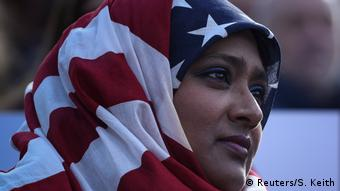 Muslim woman wearing US flag as headscarf (Reuters/S. Keith)