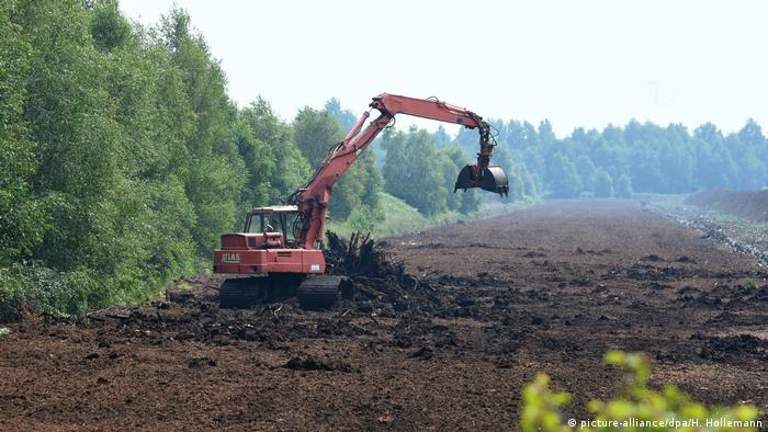 A digger removing peat from the ground