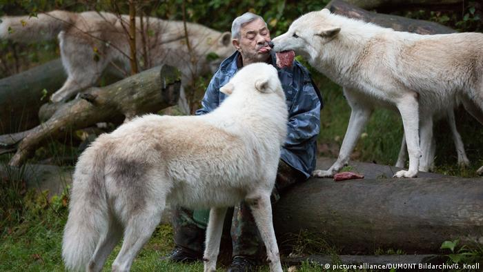Werner Freund bites into the piece of meat, behaving as the alpha male of the pack