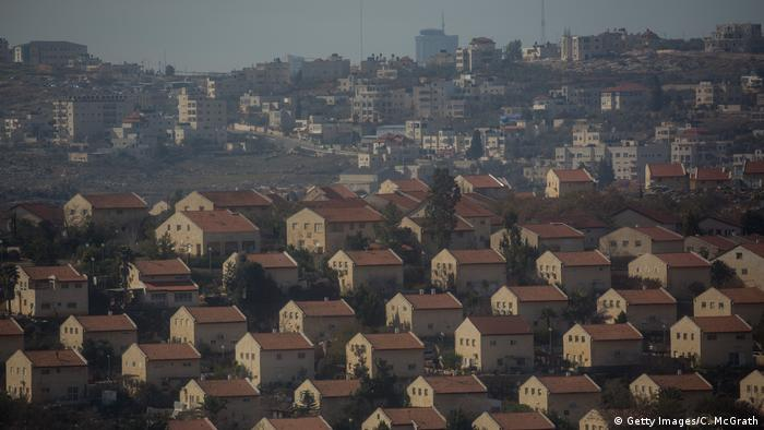 House in an Israeli settlement are seen inf ront of an Arab town in Amona, West Bank