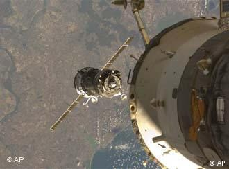 A Soyuz spacecraft docks with the International Space Station in 2008