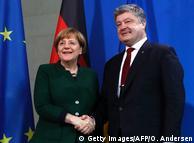 Анґела Меркель (л.) та Петро Порошенко на зустрічі в Берліні в січні 2017 року