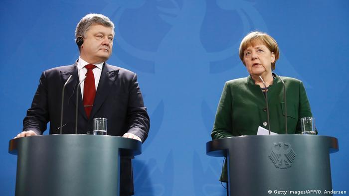 Deutschland - Angela Merkel und der ukrainische Präsident Petro Poroshenko (Getty Images/AFP/O. Andersen)
