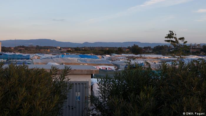 A view of the tents and sheds that make up the shantytown where many of the migrant workers live