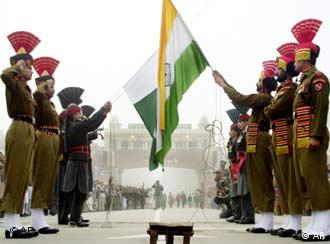 Both Indian, foreground, and Pakistani, behind, soldiers take off their respective countries flag in the evening during the Beating the Retreat ceremony, a daily ritual, at India and Pakistan Joint Border Check Post Wagha, India Friday, Dec. 28, 2001. Tension mounted along the India-Pakistan border as the Indian army ordered residents in border villages to evacuate and the air force moved more assets to the frontier air bases. Pakistan too, has deployed Medium Range ballistic missile batteries along the Line of Control. On Thursday Indian government ordered reductions in embassy staff and banned Pakistan airline entering Indian air space.
