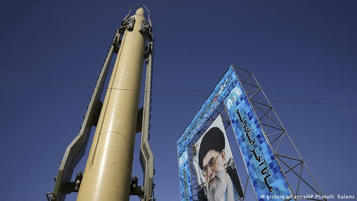 Iran's Ghadr-F rocket and a huge portrait of Khomeini in 2016