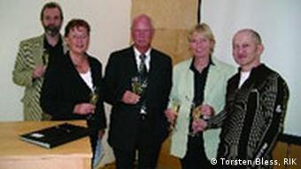 A group of 2 men and 5 women celebrating with a champagne toast