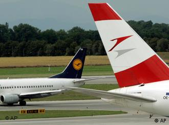 Austrian Airlines and Lufthansa jets parked side by side