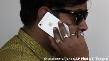 May 18, 2016. An Indian man talks on his iPhone in New Delhi, India, Wednesday, May 18, 2016. (AP Photo/Tsering Topgyal) |