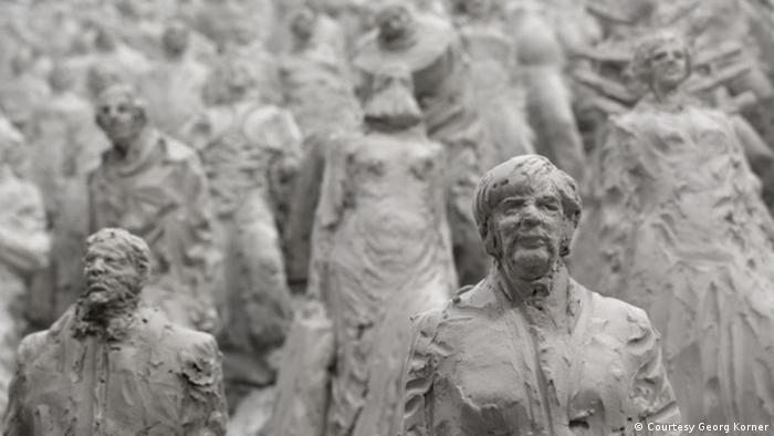Detail of installation Transit: Angela Merkel and other figures (Georg Korner)