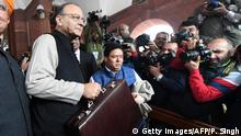 Indian Finance Minister Arun Jaitley arrives in Parliament House to present the Union Budget in New Delhi on February 1, 2017. India unveils a budget expected to contain measures to ease a cash crisis caused by its sudden decision to pull most of its currency from circulation. / AFP / PRAKASH SINGH (Photo credit should read PRAKASH SINGH/AFP/Getty Images)