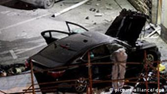 The wrecked car at the scene of the explosion that killed Pukanic
