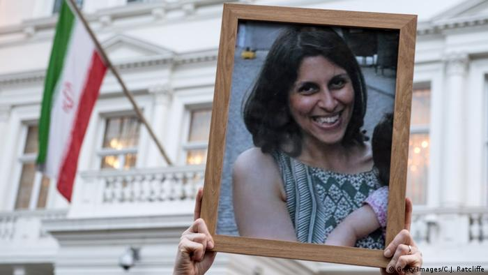 Supporters hold a photo of Nazanin Zaghari-Ratcliffe during a vigil for British-Iranian mother