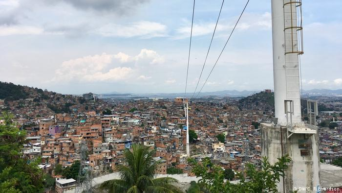 Empty cables run over the skyline of the favela Alemao